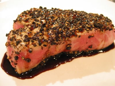 Yellowfin tuna with seared with cracked black pepper and a balsamic honey reduction.